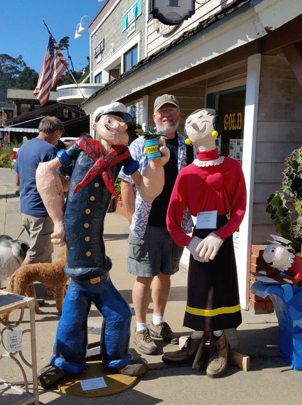 Ron posing with Popeye and Olive Oil at the Cambria Scarecrow Festival