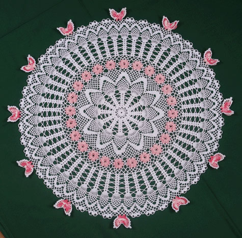 Pineapple Butterfly Rose Table Topper pattern is available at CrochetMemories.com