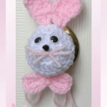www.crochetmemories.com/blog - Free pattern for a yarn Easter bunny door knob cover or egg cozy